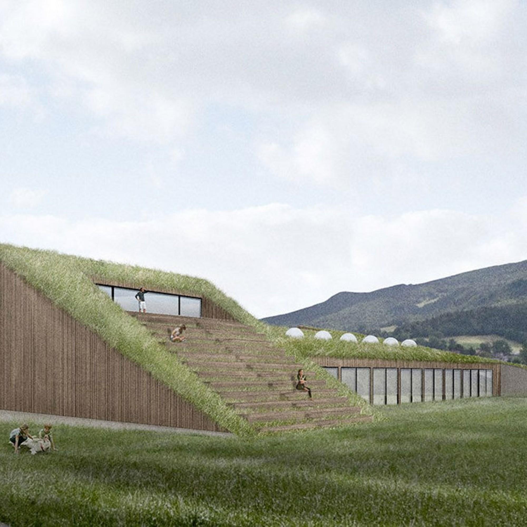 Das dreistöckige Gebäude mit Grasdach soll sich harmonisch in die Landschaft einfügen