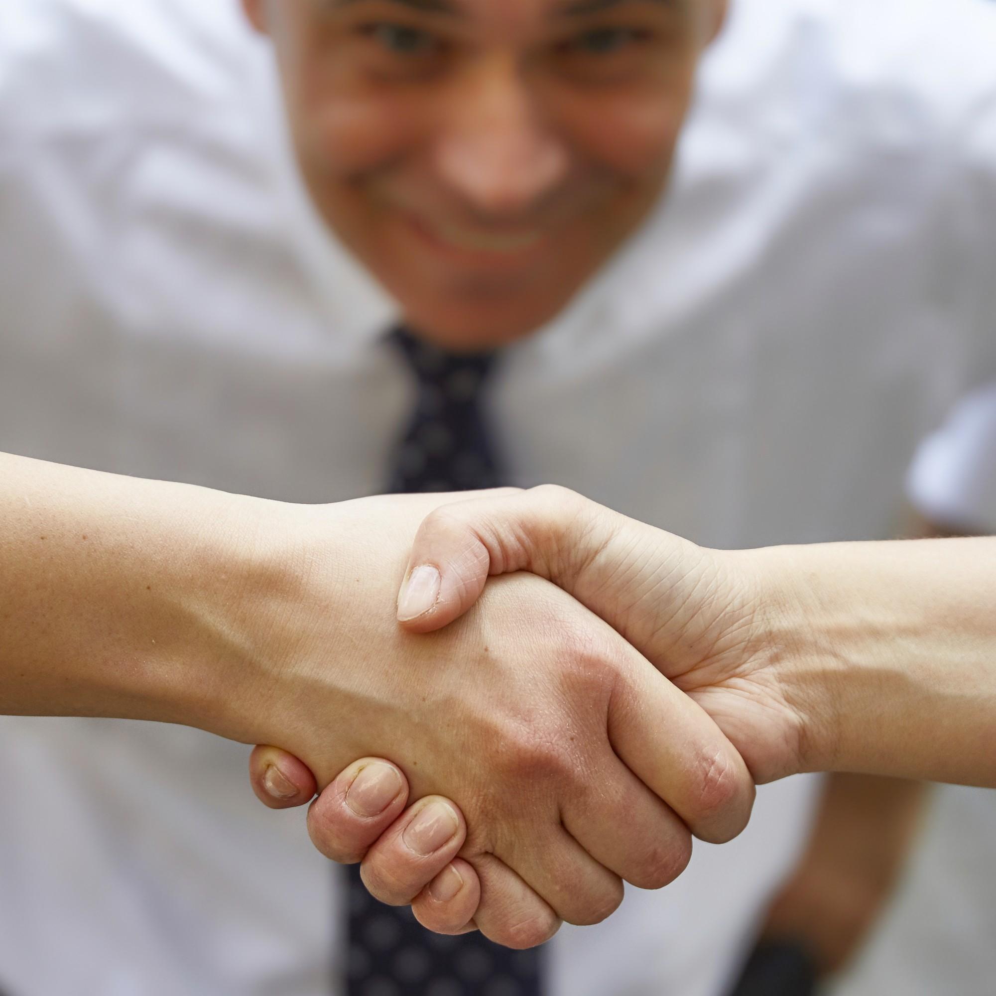 Handschlag mit Zuschauer