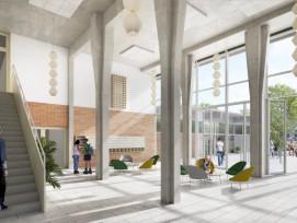 Herzstück des umgenutzten Spitalgebäudes ist ein doppelstöckiges Foyer. Von hier aus sind die öffentlichen Nutzungen im Parterre über eine innere Gasse erschlossen.