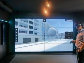 Virtuelle Begehung eines 3D-Modells im «Decision Room»: Die Digitalisierung bringt für den Besteller und Bauherrn von Anfang an Klarheit darüber, welches Gebäude ihm dereinst übergeben wird.