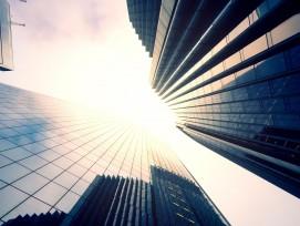 Sonne über Hochhäusern (Symbolbild)